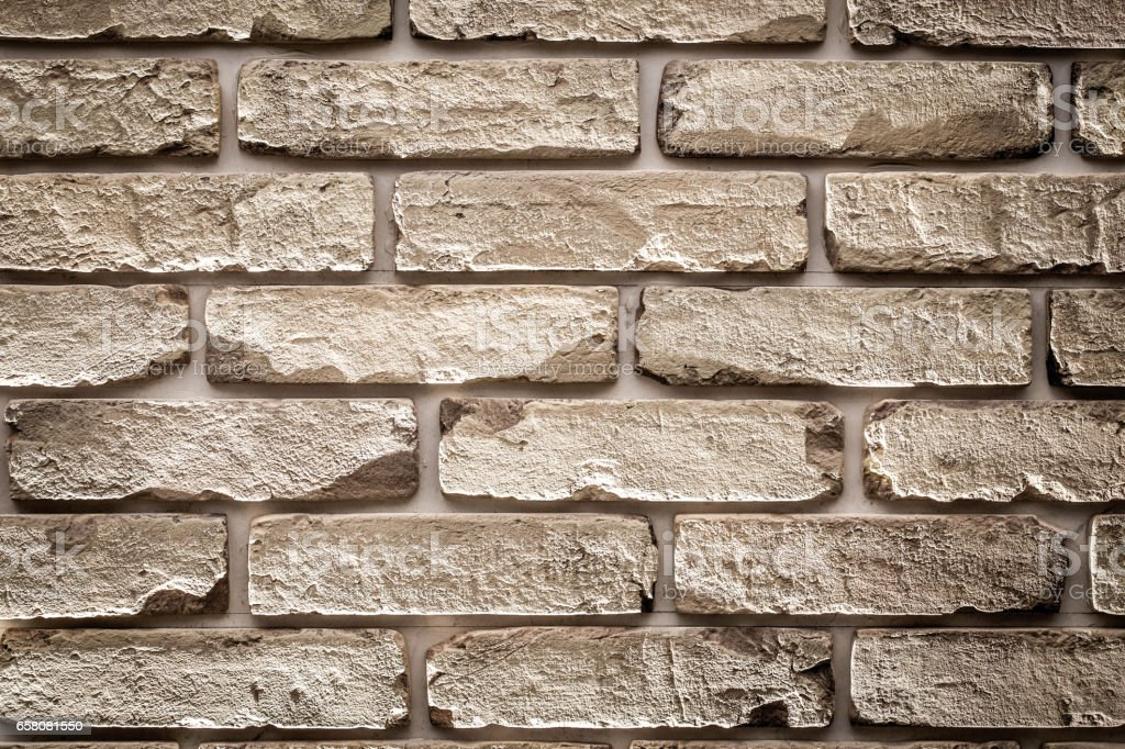 Beige brick wall royalty-free stock photo
