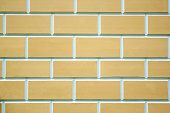 Beige bricks wall texture. New clean beige bricks background