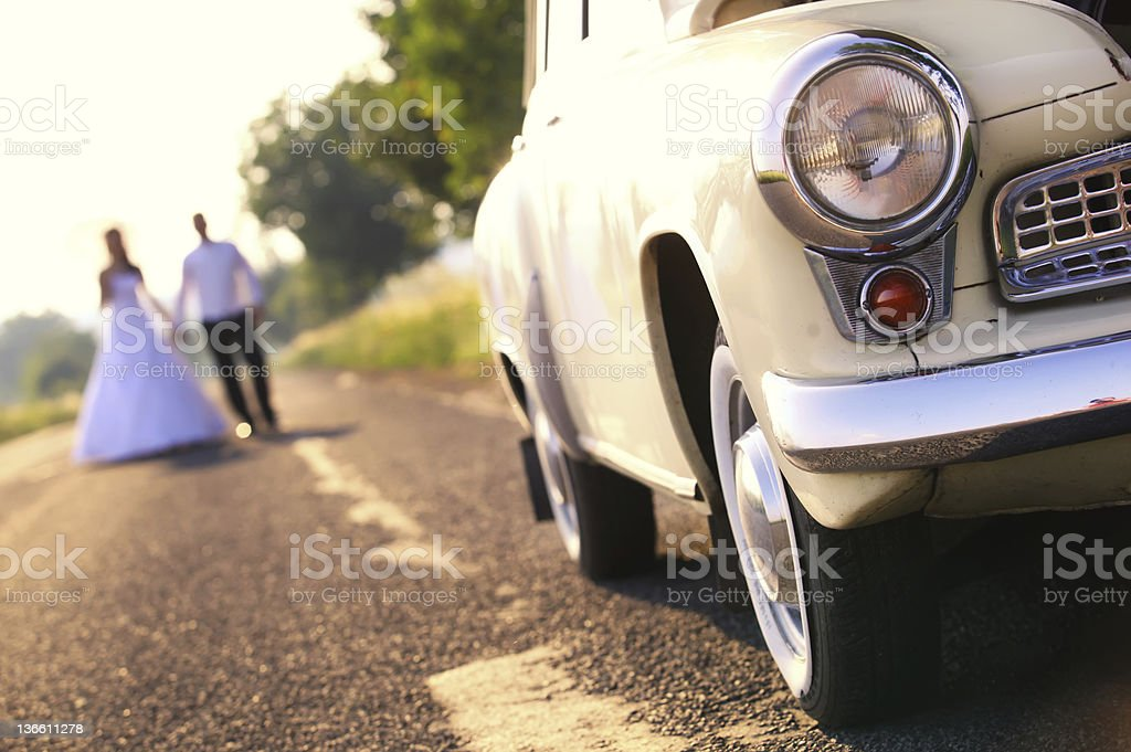 Beige car and weding couple stock photo