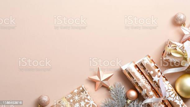 Beige christmas background with festive decorations baubles pine tree picture id1186453616?b=1&k=6&m=1186453616&s=612x612&h=jnjbnjhyu21lpadqb jaymogc cbwh6whp10juiczwg=