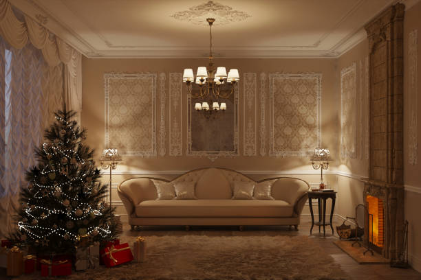beige klassische wohnzimmer mit kamin am abend - alten kronleuchter stock-fotos und bilder