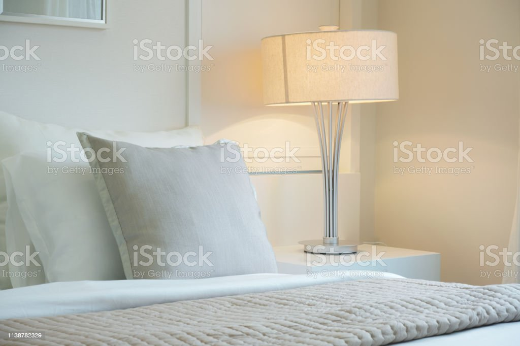 Beige Color Scheme Bedding With White Reading Lamp In Modern ...