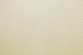 istock beige colored vintage paper texture or canvas background 1147477510
