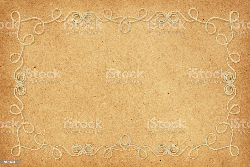 Beige cotton rope frame on craft paper foto stock royalty-free