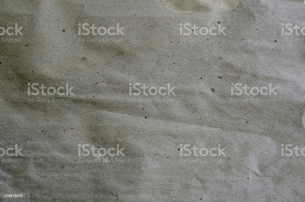 Beige crumpled paper for background royalty-free stock photo