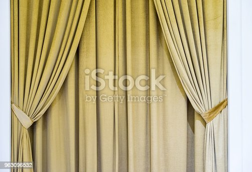 Beige curtain on the window in the room