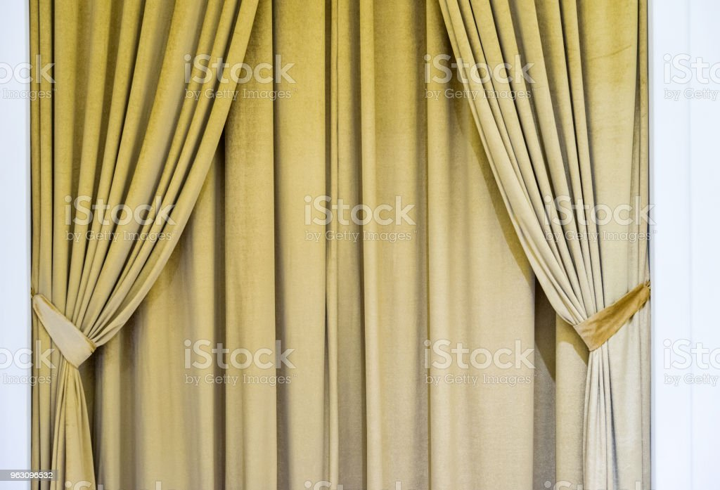 Beige curtain on the window in the room stock photo
