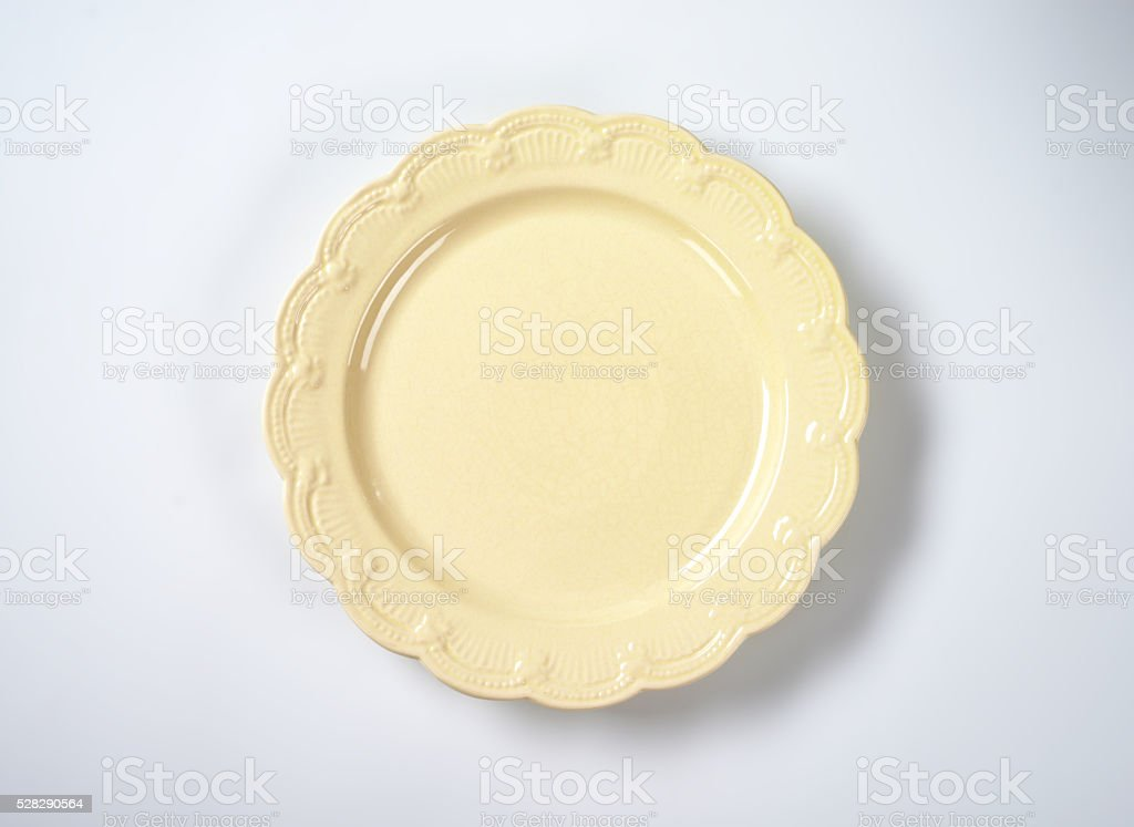 beige decorative plate stock photo