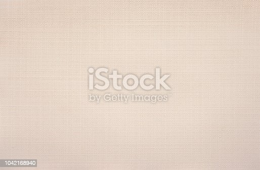 istock Beige fabric background 1042168940