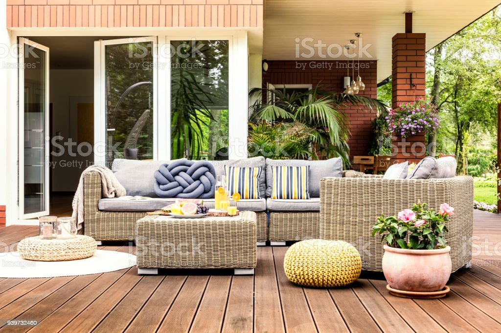 Beige garden furniture on terrace stock photo