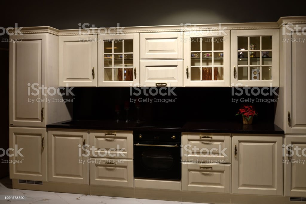 A Beige kitchen set with stove in the room