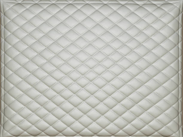 Beige leather background with rhombus bumps stock photo