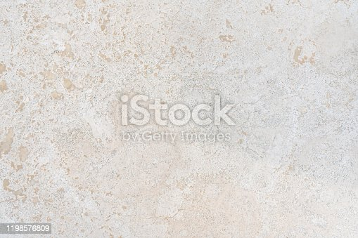 Beige limestone similar to marble natural surface for bathroom or kitchen countertop. High resolution texture and pattern.
