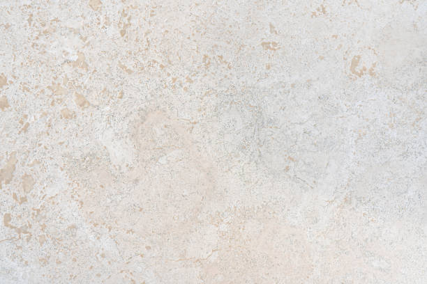 Beige limestone similar to marble natural surface or texture for floor or bathroom Beige limestone similar to marble natural surface for bathroom or kitchen countertop. High resolution texture and pattern. granite rock stock pictures, royalty-free photos & images