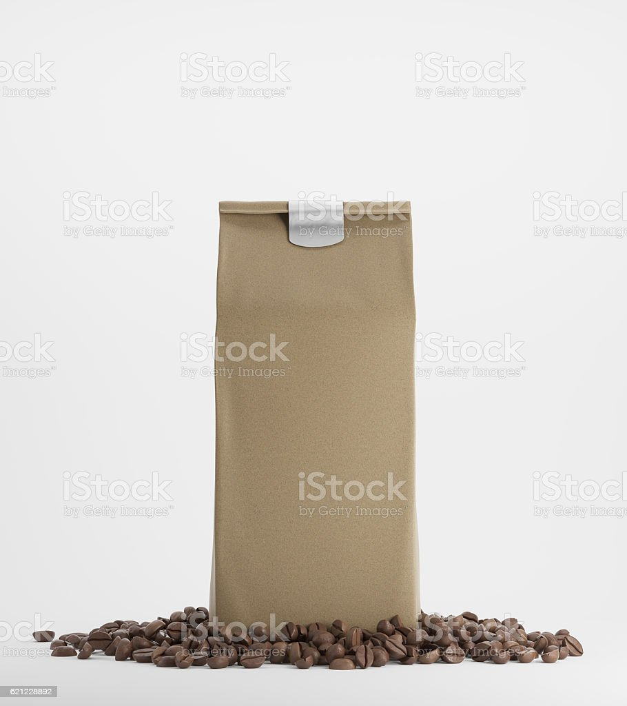 Beige pack of coffee against white background stock photo
