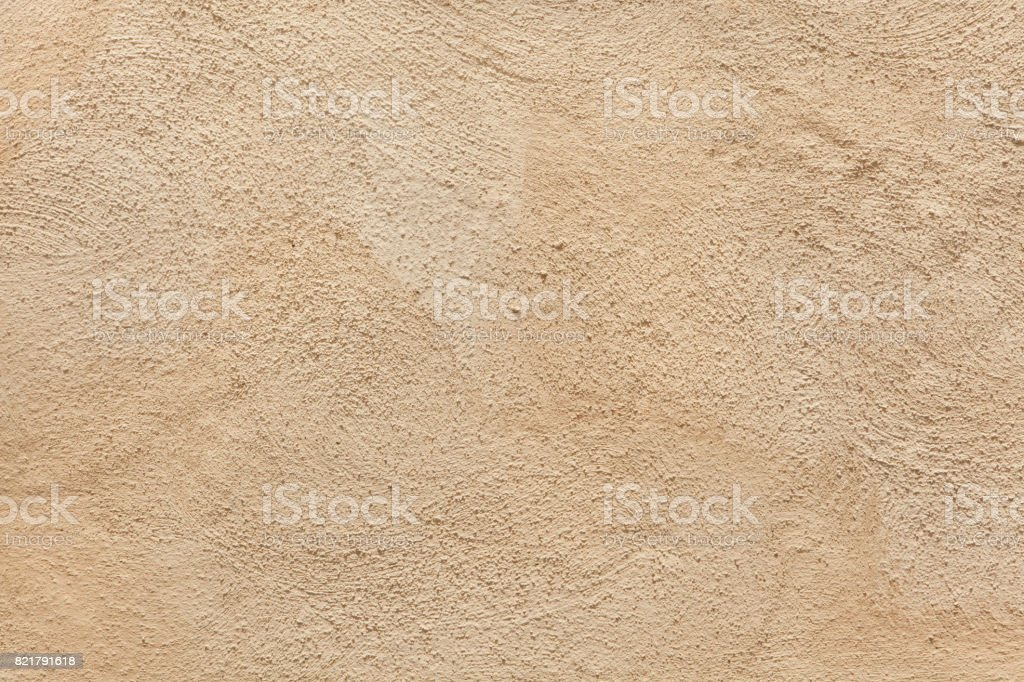 Beige painted stucco wall. stock photo