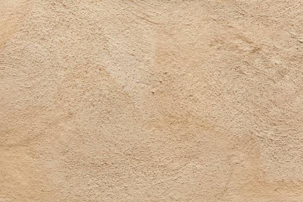 pared de estuco pintado de beige. - estuco fotografías e imágenes de stock