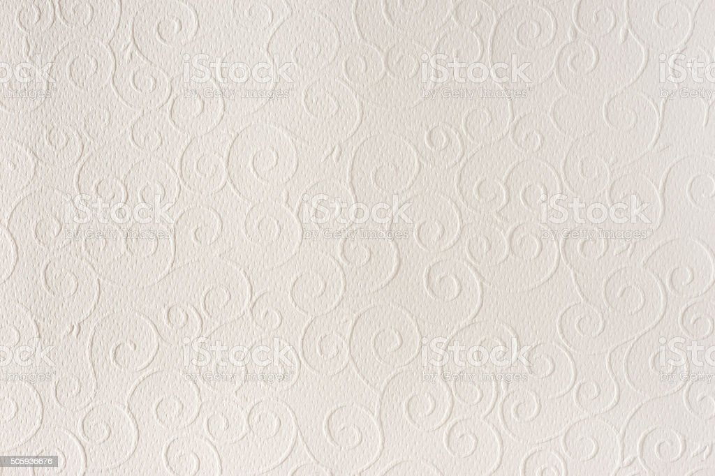 Beige paper texture background. Shells, waves, circles, shapes embossed pattern. stock photo
