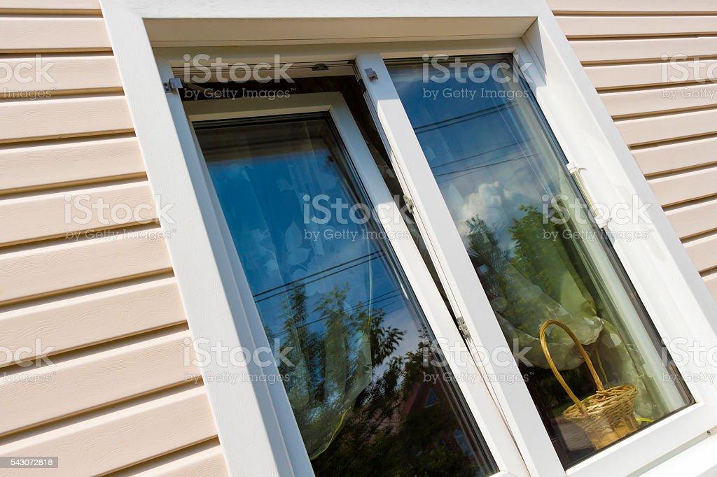 Beige plastic siding and windows stock photo