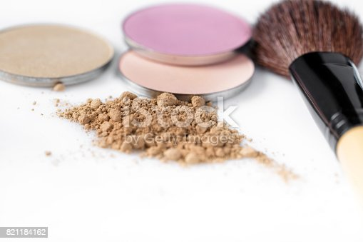 istock beige powder for face, eye shadow and makeup brush  on white background 821184162