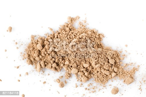 istock Beige powder for face isolated on white background 821184118