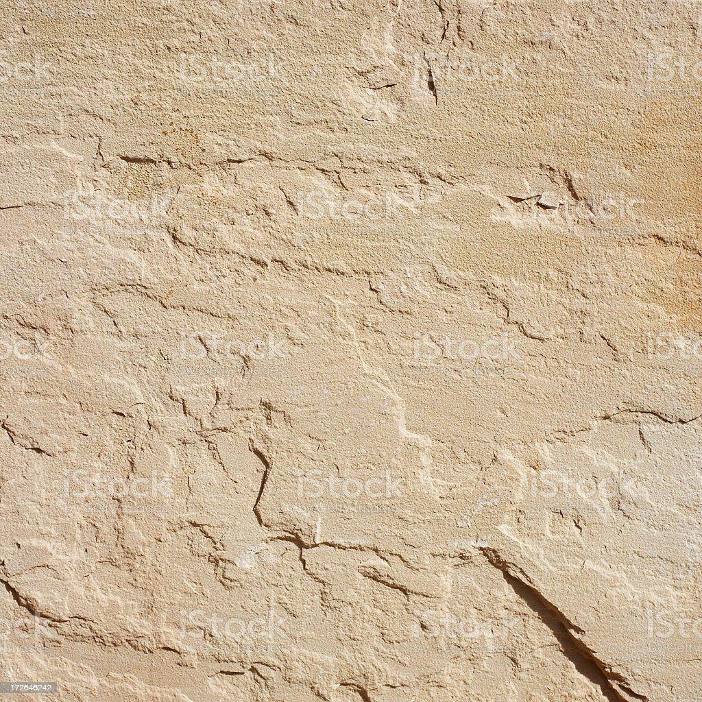 Beige sandstone texture in sun royalty-free stock photo