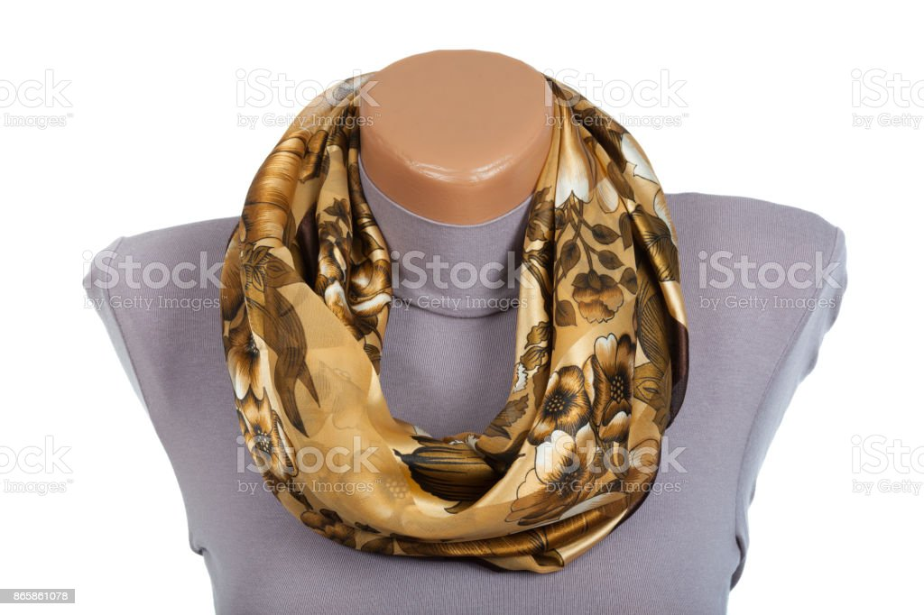 Beige scarf on mannequin isolated on white background. stock photo