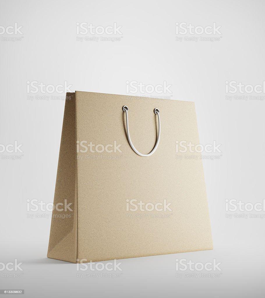 Beige shopping bag against white background - foto de stock