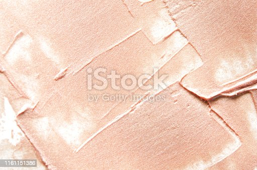 Beige smears of crushed highlighter or luminizer. - Image