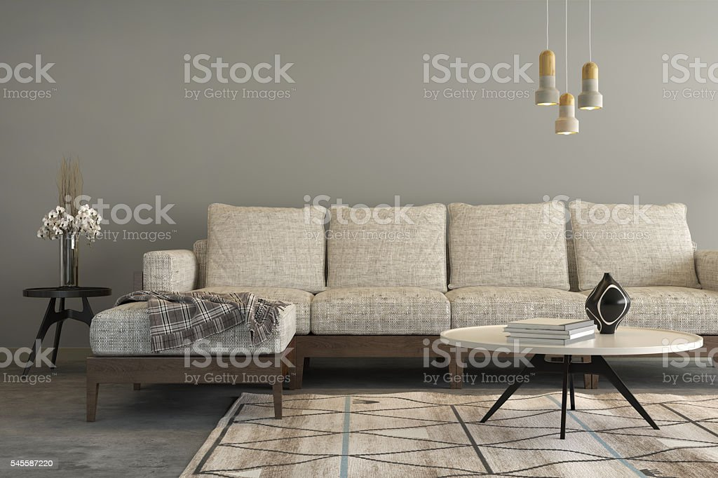 Beige sofa with a living room like setup around it stock photo