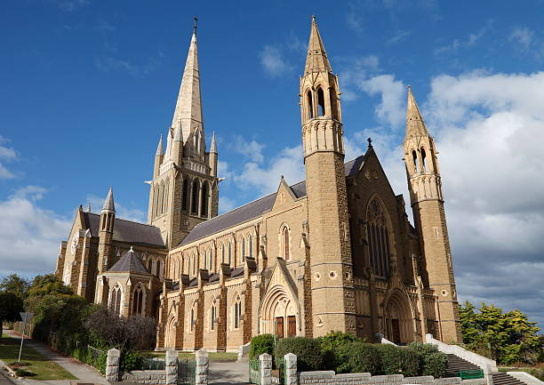 Beige stone cathedral against the blue sky stock photo