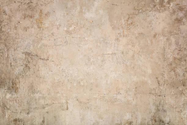 bej renkli sıva doku arka plan - taş i̇nşaat malzemesi stok fotoğraflar ve resimler