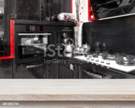 834157738istockphoto Beige table on defocused black kitchen background 481350734
