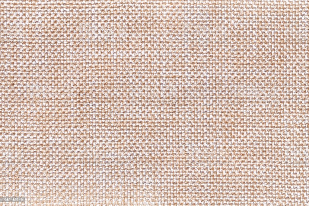 Beige textile background closeup. Structure of the fabric macro royalty-free stock photo