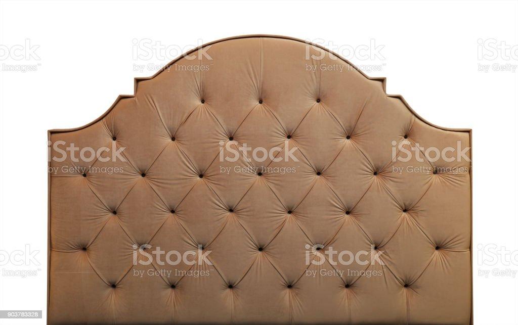 Beige velvet bed headboard isolated on white stock photo