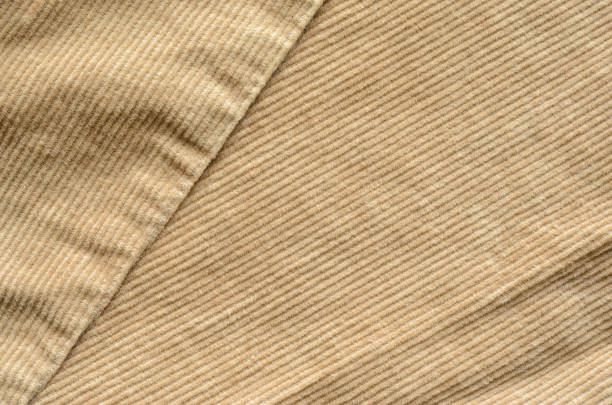 beige velvet cloth texture with stitches - corduroy stock pictures, royalty-free photos & images