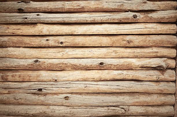 beige wall from wooden logs knots - holzstamm stock-fotos und bilder