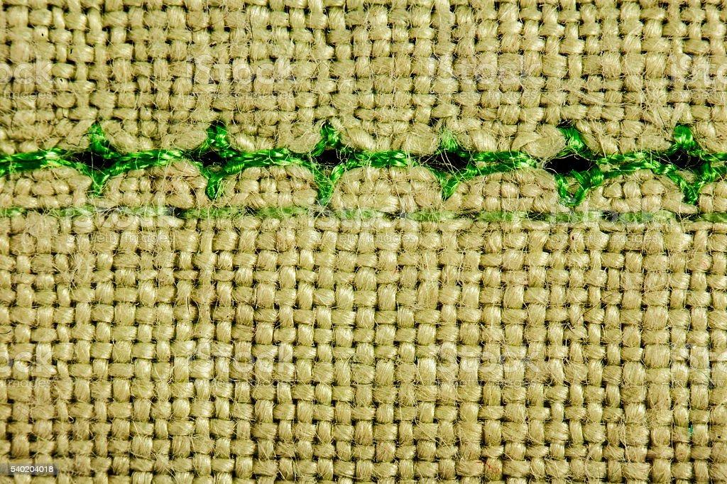 beige wool texture background green seam stock photo