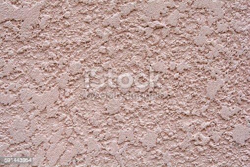 istock Beige-Magenta Wall Texture 591443954