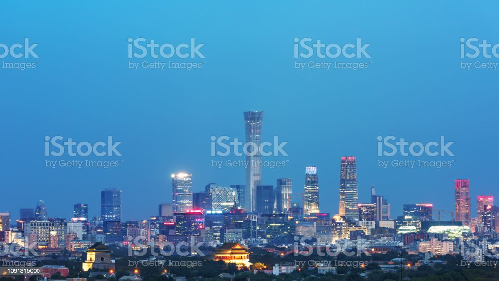 Beijing Bell Tower and Drum Tower and modern CBD night view are very spectacular. stock photo