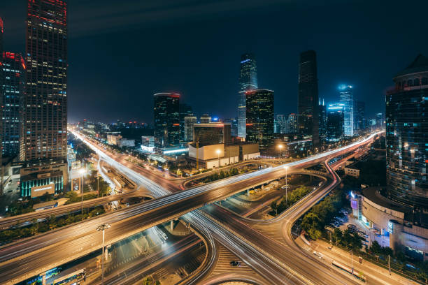 beijing central business district at night - urban sprawl stock photos and pictures