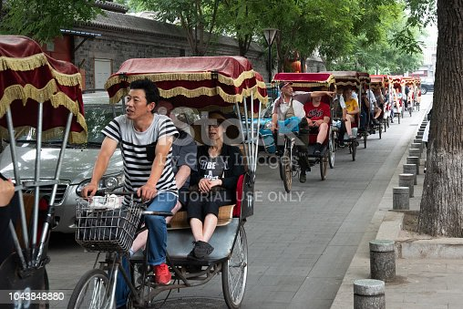 Beijing, China, June 6,2018: Tourist people at rickshaw taxis traveling around and enjoying the landmarks of Beijing City in China.