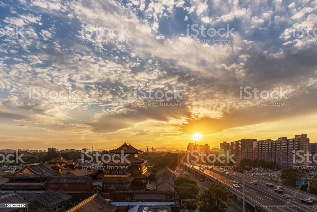 Beijing Lama Temple and urban road traffic in the sunset