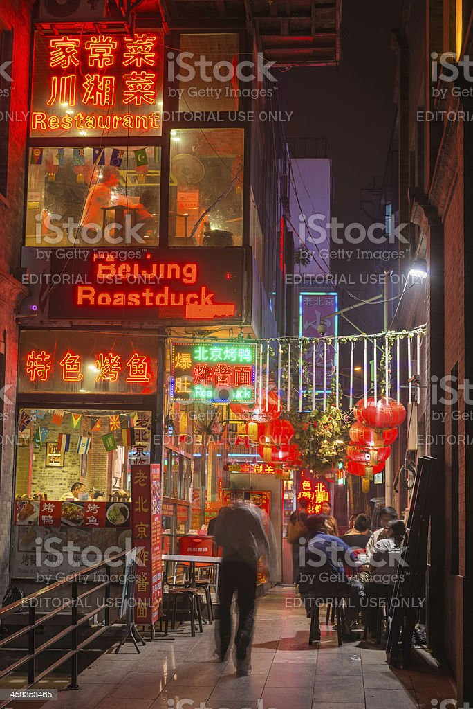 Beijing neon signs on night restaurants Qianmen China royalty-free stock photo