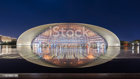 Beijing,China - May 16, 2019: The National Center for the performing arts, the National Grand Theater like an egg shape,reflection is clearly at night.A landmark building as one of the new 16 scenes in Beijing.