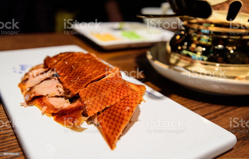Beijing roasted sliced duck dinner on white plate with sides stock photo