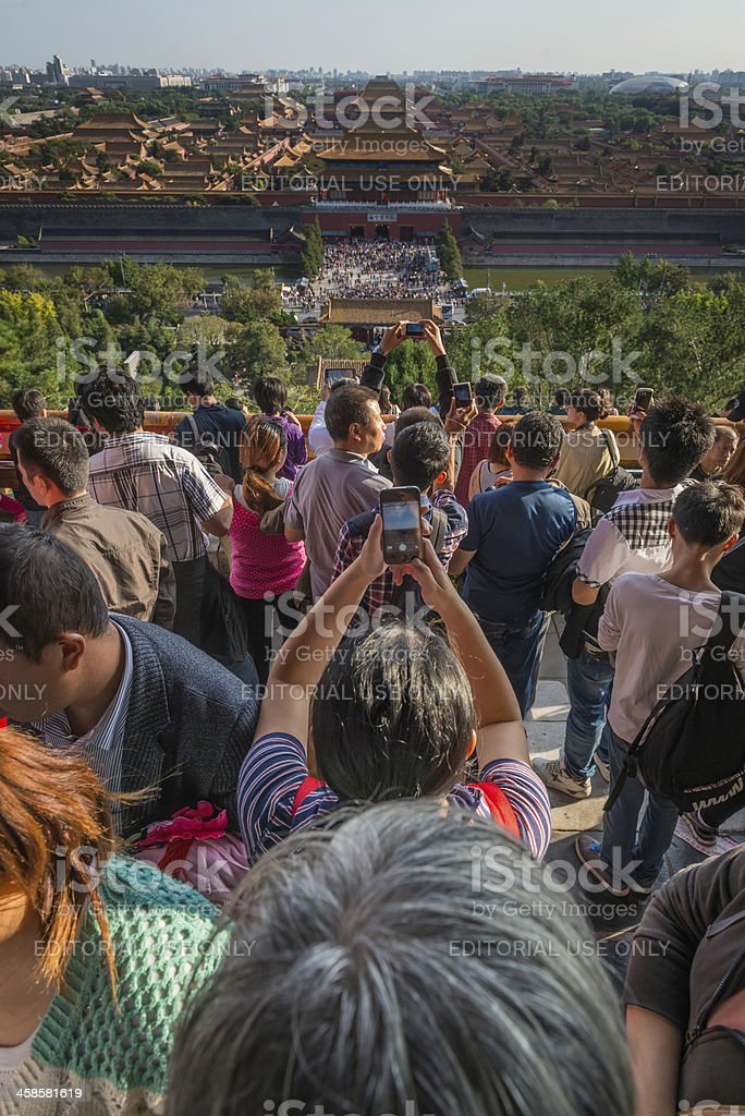 Beijing tourist crowds photographing the Forbidden City with cellphones China stock photo