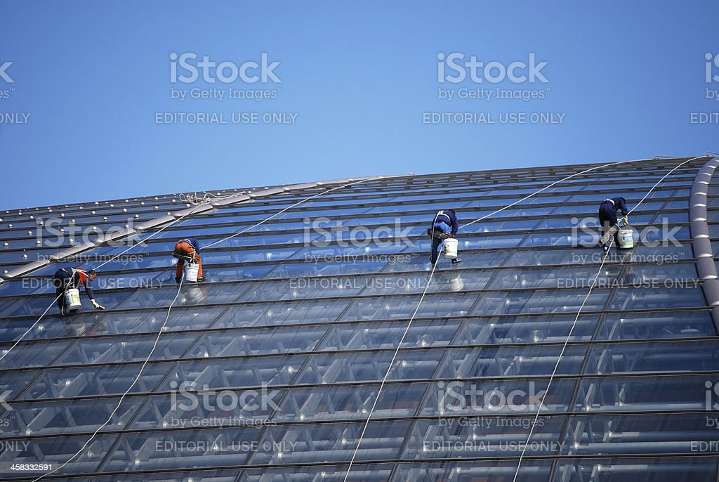 Beijing window cleaners at work on the Giant Egg stock photo