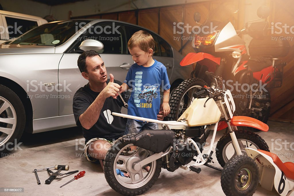 Being a role model to his little boy stock photo