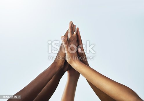 Studio shot of unrecognizable women's hands against a grey background